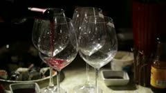 Red wine is poured in the glasses. Close up. Stock Footage
