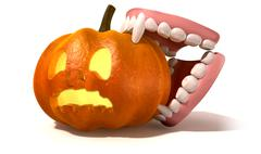 Vampire teeth biting jack o'lantern Stock Illustration