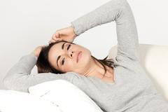 Stock Photo of woman on sofa