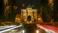 TL day to night with slight zoom-in - Victory Gate Munich - Siegestor Muenchen Stock Footage