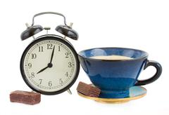 Alarm clock wuth cup of coffee Stock Photos