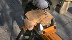Carver in agriculture fair carving wood object Stock Footage