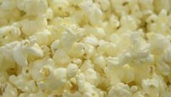 Close up of pop corn landing on a pile of more pop corn Stock Footage