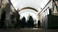 People crowd in the tunnel. Metro station. - stock footage