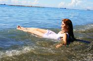 Woman in sea Stock Photos