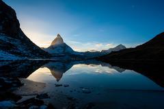 matterhorn and dente blanche from riffelsee mountain lake above zermatt - stock photo