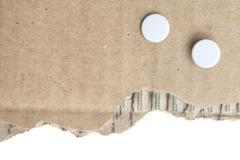 Piece of cardboard with punch holes Stock Photos