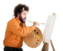 Eccentric painter in frantic painting Stock Photos