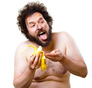 Caveman eating a banana Stock Photos