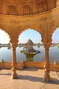 Old jain cenotaphs on lake in jaisalmer india Stock Photos