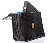 black ring binder in an open briefcase - stock photo