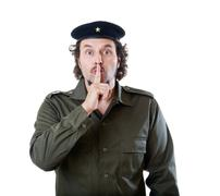 guerilla marketing guy silencing the viewers - stock photo