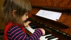 Little Baby Girl Plays Piano -  Piano Player Stock Footage