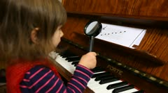Baby Girl Studies Musical Staff with Magnifier Lens Stock Footage