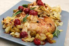 chicken with cherry sauce. - stock photo
