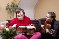 Two women make a music therapy Stock Photos