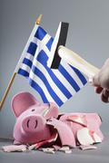 Robbing greek piggy bank Stock Photos