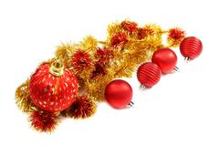 Christmas balls and a gold tinsel. Stock Photos