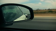 Side View Mirror Looking Back Driving Stock Footage