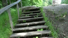 Climb upstair wooden stair old stone pagan altar on top of hill Stock Footage