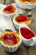 Cheese souffle with cherry sauce. Stock Photos