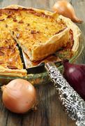 Alsatian onion pie with ham. Stock Photos