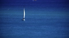 Sailboat in the ocean - stock footage