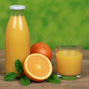 Fresh oranges and juice Stock Photos