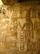 Luxor: stone carvings of the pharaoh and his wife surrounded by hieroglyphs, Stock Photos