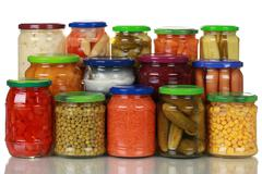 Vegetables in glass jars Stock Photos
