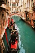 Venice: traditional gondola waiting for a romantic ride, near Canal Grande - stock photo