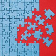 concept finishing a jigsaw puzzle - stock photo