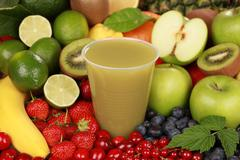 Juice made from green fruits Stock Photos