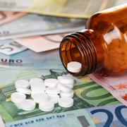 high cost of healthcare with medicine on euro banknotes - stock photo