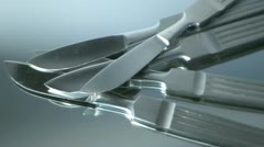 Five Scalpels rotating on mirror Stock Footage