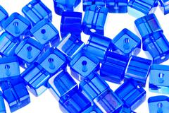 Blue glass cubic bugles close up Stock Photos