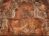 Stock Photo of Beautiful red sandstone carving at Banteay Srei temple near Angkor Wat, Cambodia