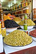 Stock Photo of colored pickled olives and vegetables on a market stall in the main souk of m
