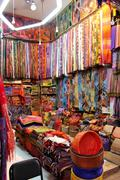 Colorful silk and carpet store in the souks of the old medina of marrakesh Stock Photos