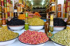 Colored pickled olives and vegetables on a market stall in the main souk of m Stock Photos