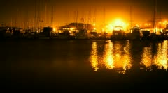 Boats in Harbor At night Stock Footage