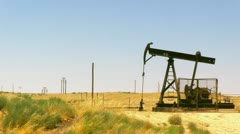 Wide Angle Oil Rig Pumping in California Stock Footage