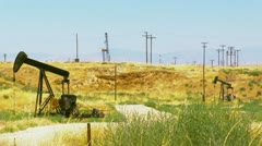 Oil rig field in California Stock Footage