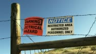 Stock Video Footage of Warning and Restricted signs on Barbed Wire