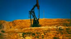 Oil Drill on Hillside Stock Footage