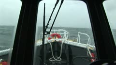 Pilot boat with waves hitting window - stock footage