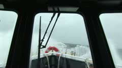 Pilot boat swaying in rough waters Stock Footage