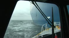 Pilot boat next to cargo ship Stock Footage
