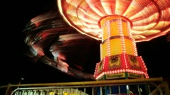Swing Carousel spins at Night Stock Footage