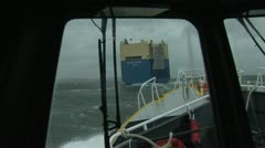 Pilot boat with cargo ship Stock Footage